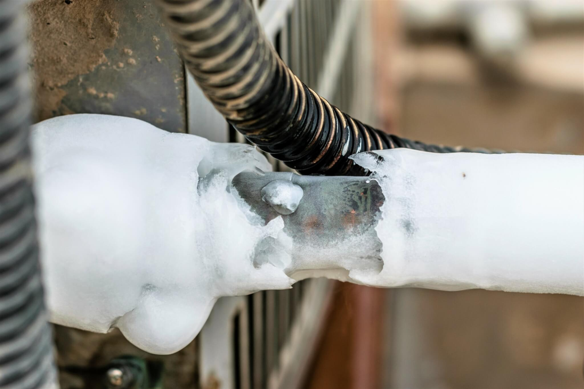 ac cooling air pipes covered by snow or frozen because of super performance of heavy duty central air conditioning system on the roof top in hot summer days